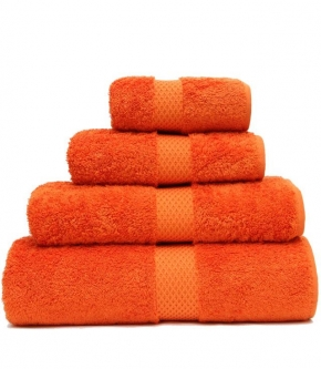 Полотенца хлопковые Deluxe. Полотенце гостевое (45х70), для рук (55х100), для душа (70х140) и банное (92×160) Etoile Orange (Этуаль Оранж) от Yves Delorme